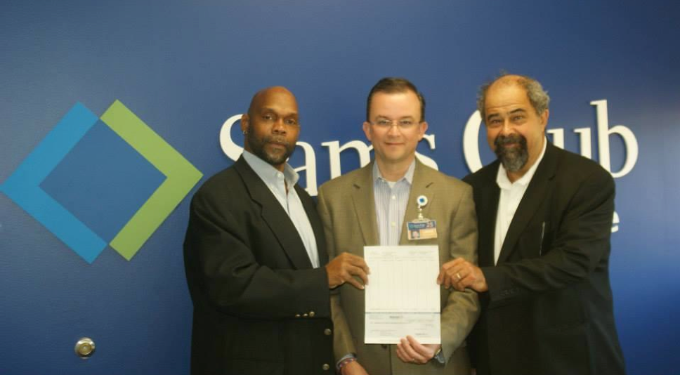 Pictured, left to right: Kevin Wortham, Executive Director of Minding Our Business (MOB), Lance de la Rosa, Senior Vice President of Operations at Sam's Club, and Dr. Sigfredo Hernandez, MOB's Co- Founder and Treasurer during a recent check presentation ceremony
